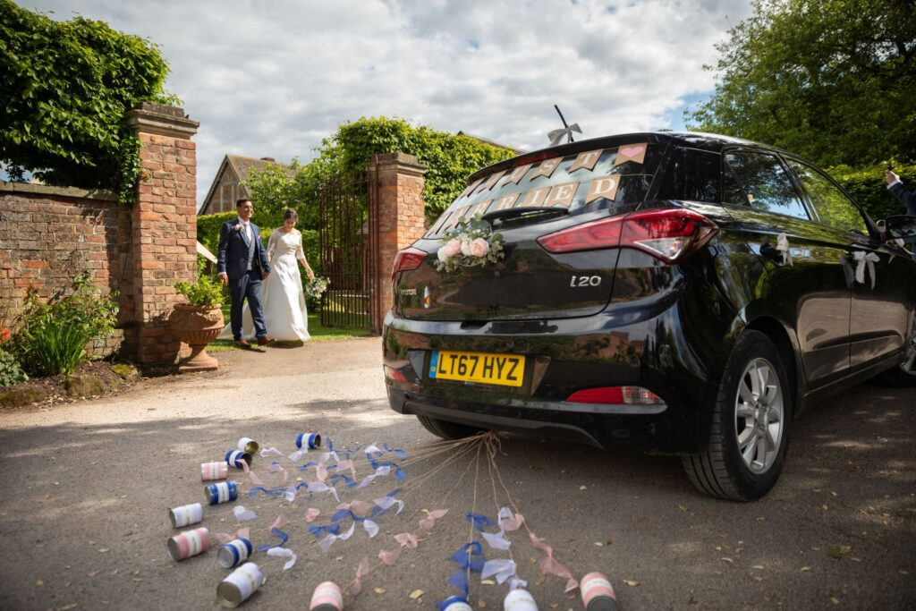 104 just married cans tied to bridal car pauntley court gloucester oxfordshire wedding photographers
