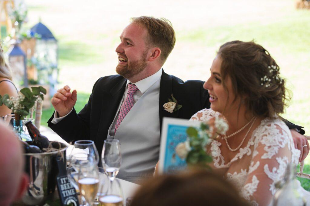 104 laughing bride groom wedding breakfast marquee winkfield berkshire oxfordshire wedding photographer