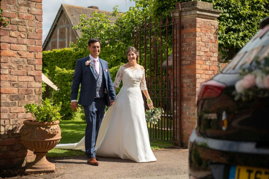 105 bride groom walk to bridal car pauntley court gloucester oxfordshire wedding photography