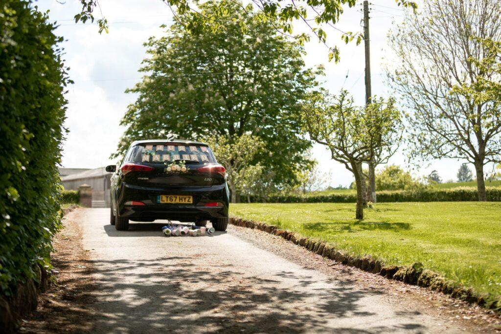 107 bridal car departs pauntley court gloucester oxford wedding photographers