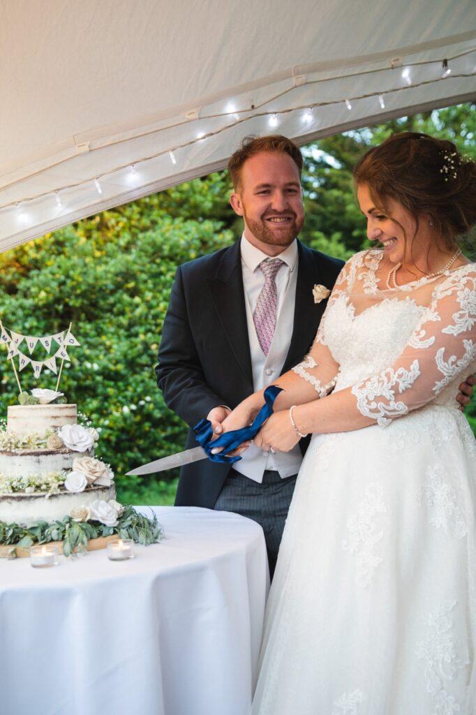 112 bride groom cake cutting ceremony winkfield wedding breakfast berkshire oxfordshire wedding photographers