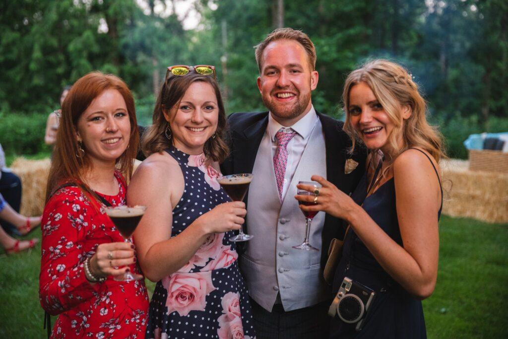 116 groom bridesmaid guests enjoy cocktail garden party winkfield berkshire oxford wedding photography
