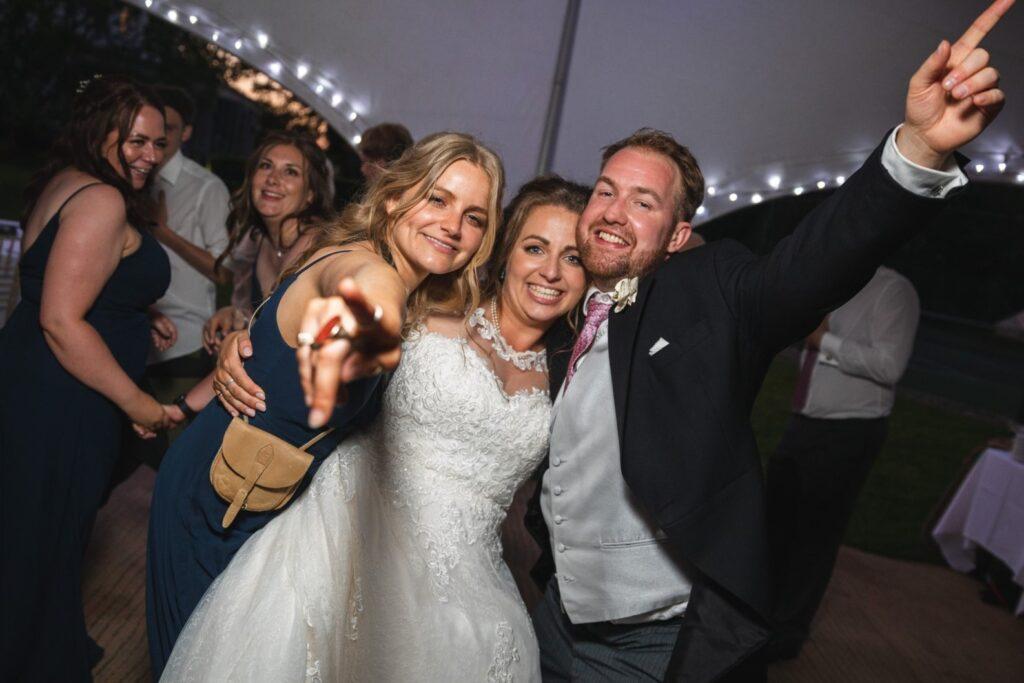 126 bride groom bridesmaid enjoy dancing winkfield marquee party berkshire oxfordshire wedding photography