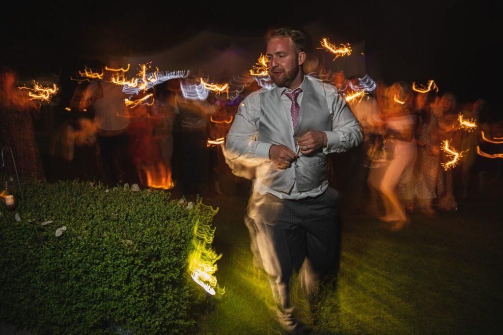 128 groom enjoys sparkler parade winkfield berkshire wedding party oxford wedding photography