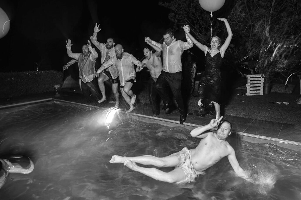 129 wedding party leap into swimming pool winkfield berkshire oxfordshire wedding photographer