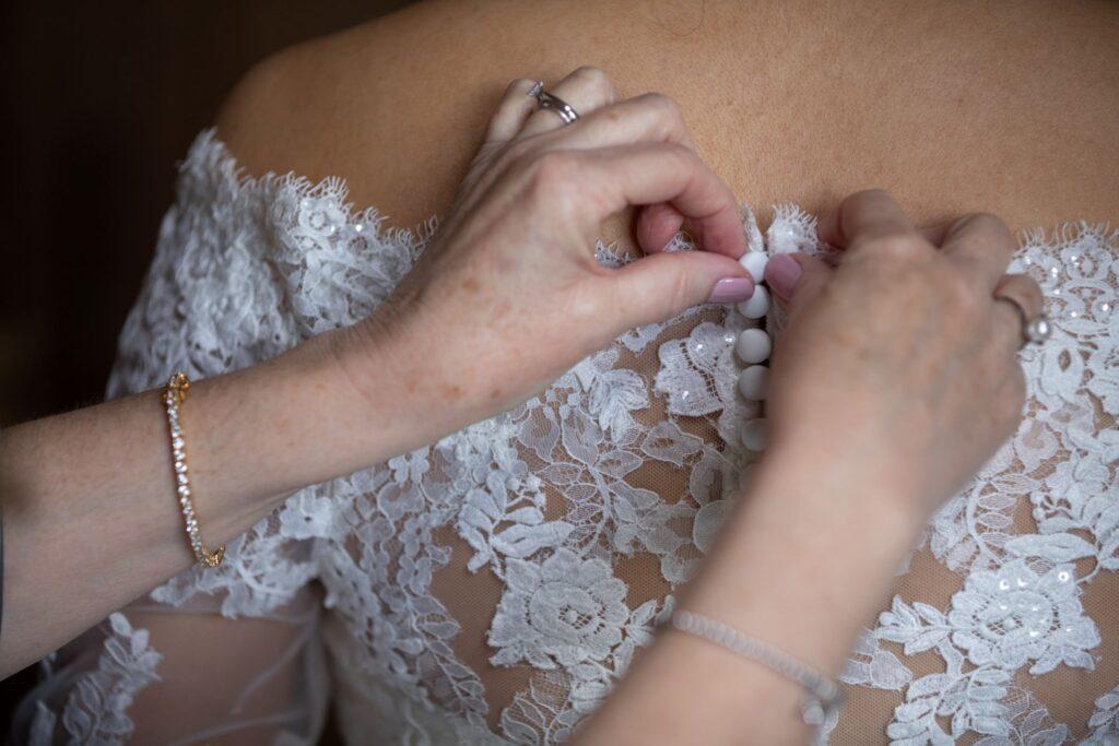 25 brides dress buttoned bridal prep pauntley court gloucester oxford wedding photographer
