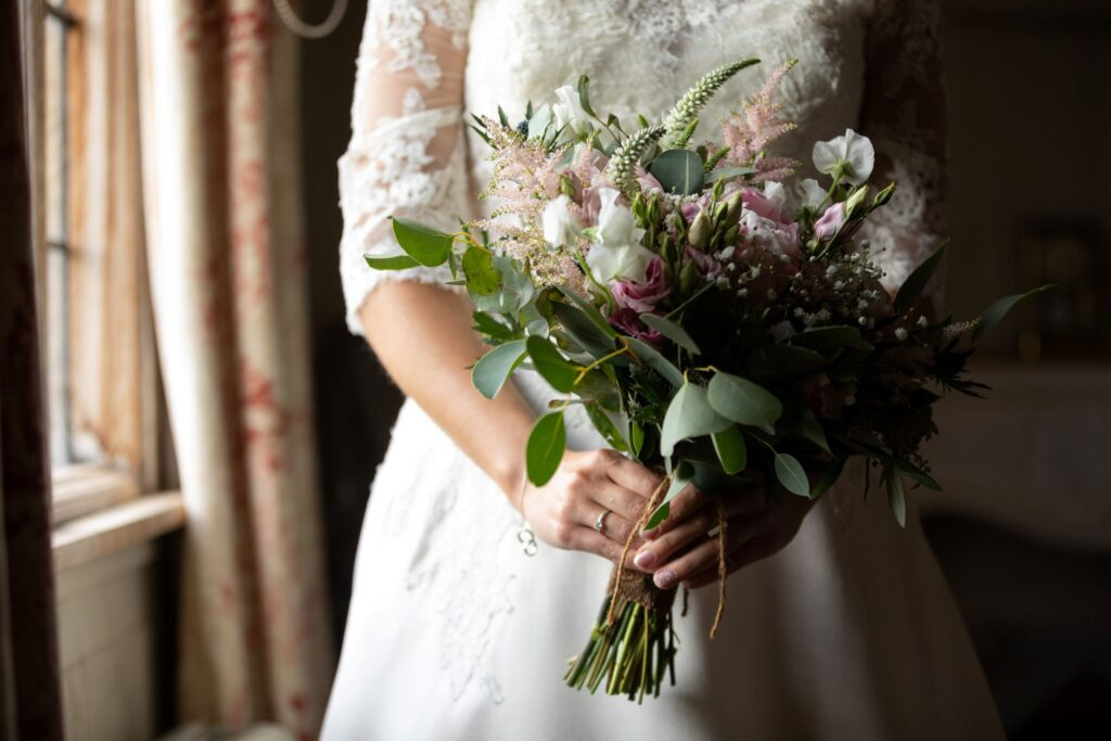 27 bride holds bouques bridal preparation pauntley court gloucester oxford wedding photography