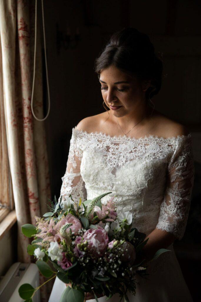 27 bride holds bouquet bridal preparation pauntley court gloucester oxford wedding photography