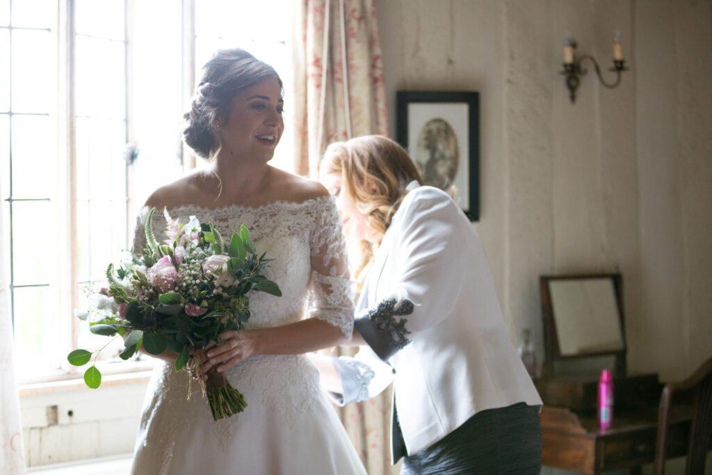 29 smiling brides dress adjustment bridal prep pauntley court gloucester oxfordshire wedding photographers