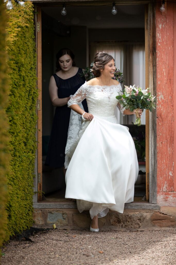 34 bride walks to marriage ceremony holding bouquet pauntley court gloucester oxfordshire wedding photographer