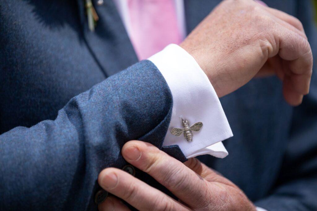 36 grooms bee cufflink marriage ceremony pauntley court gloucester oxfordshire wedding photography