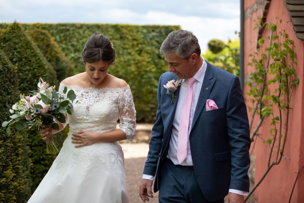 37 bride walking to marriage ceremony pauntley court gloucester oxford wedding photographer
