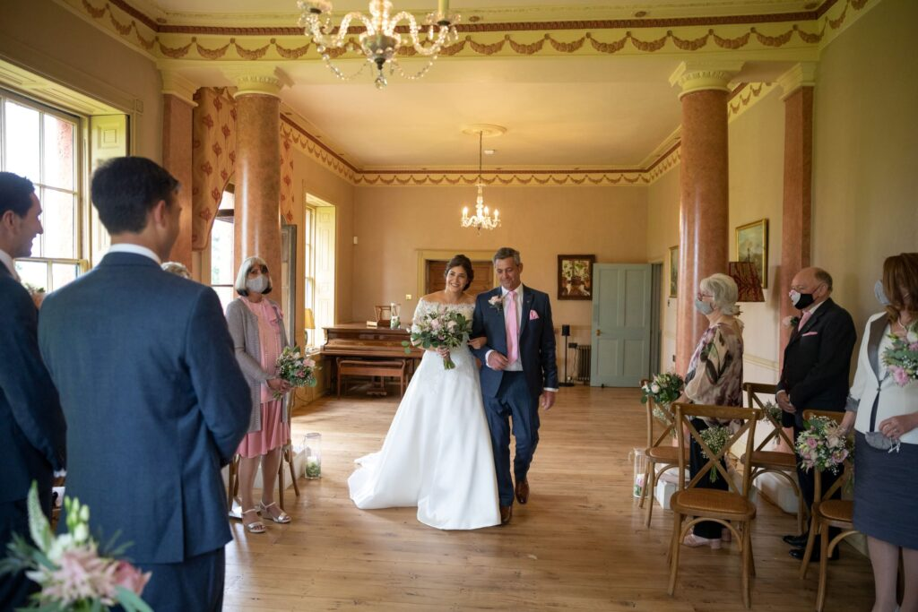 39 bride steps into marriage ceremony room pauntley court gloucester oxford wedding photography