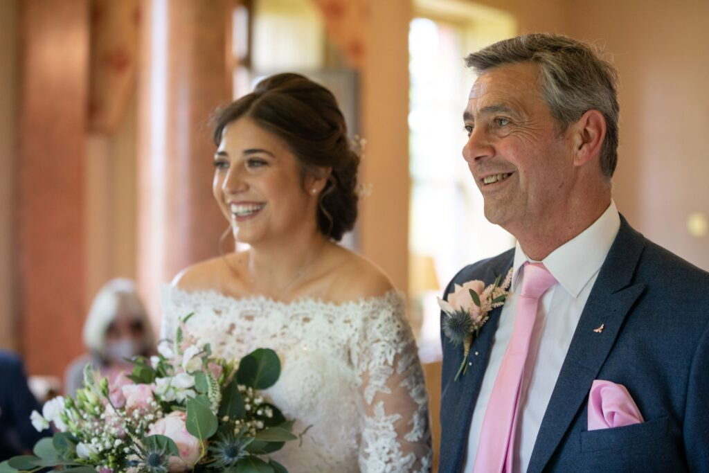 41 smiling bride greets groom marriage ceremony pauntley court gloucester oxfordshire wedding photographers