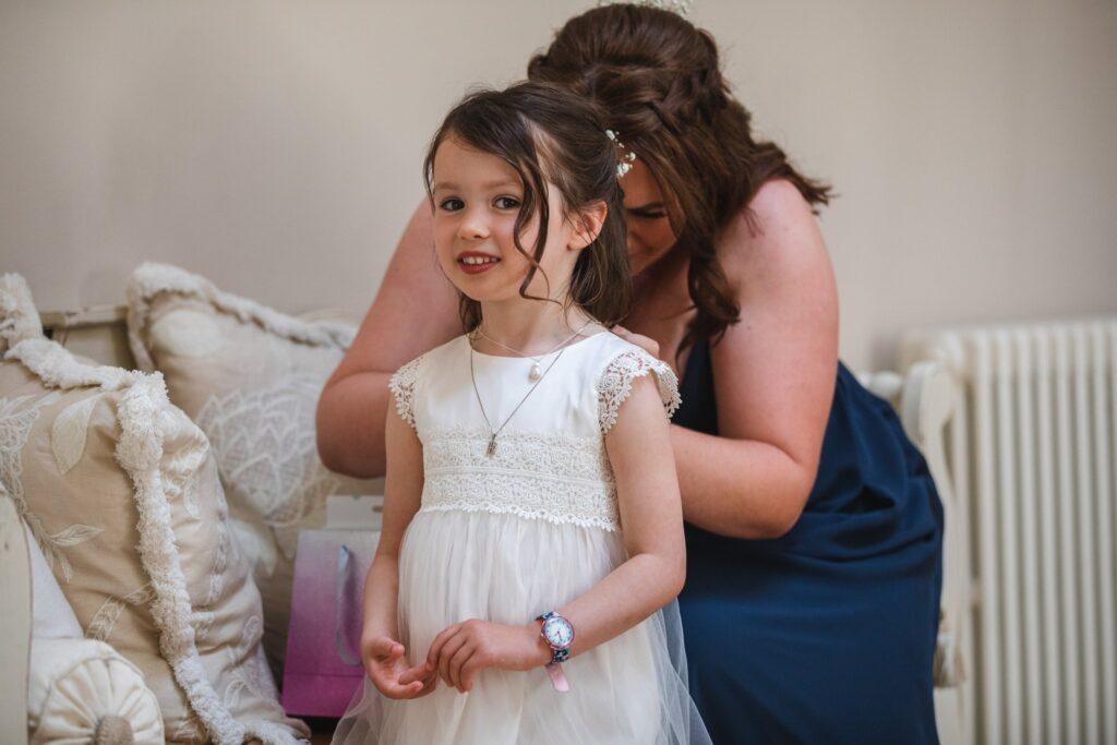 42 flowergirls dress buttoned bridal prep winkfield berkshire oxford wedding photographers