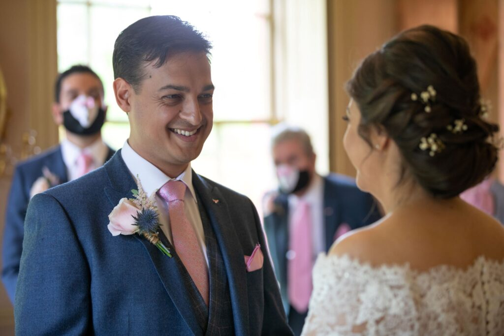 44 smiling groom marriage ceremony pauntley court gloucester oxford wedding photographers