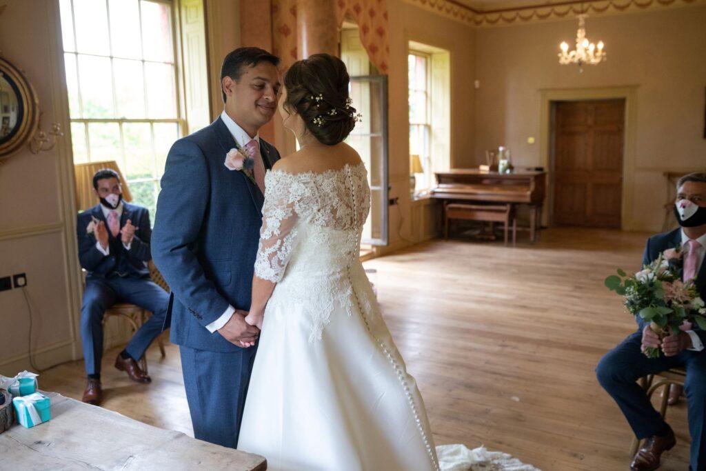 46 bride groom hold hands marriage ceremony pauntley court gloucester oxfordshire wedding photographer