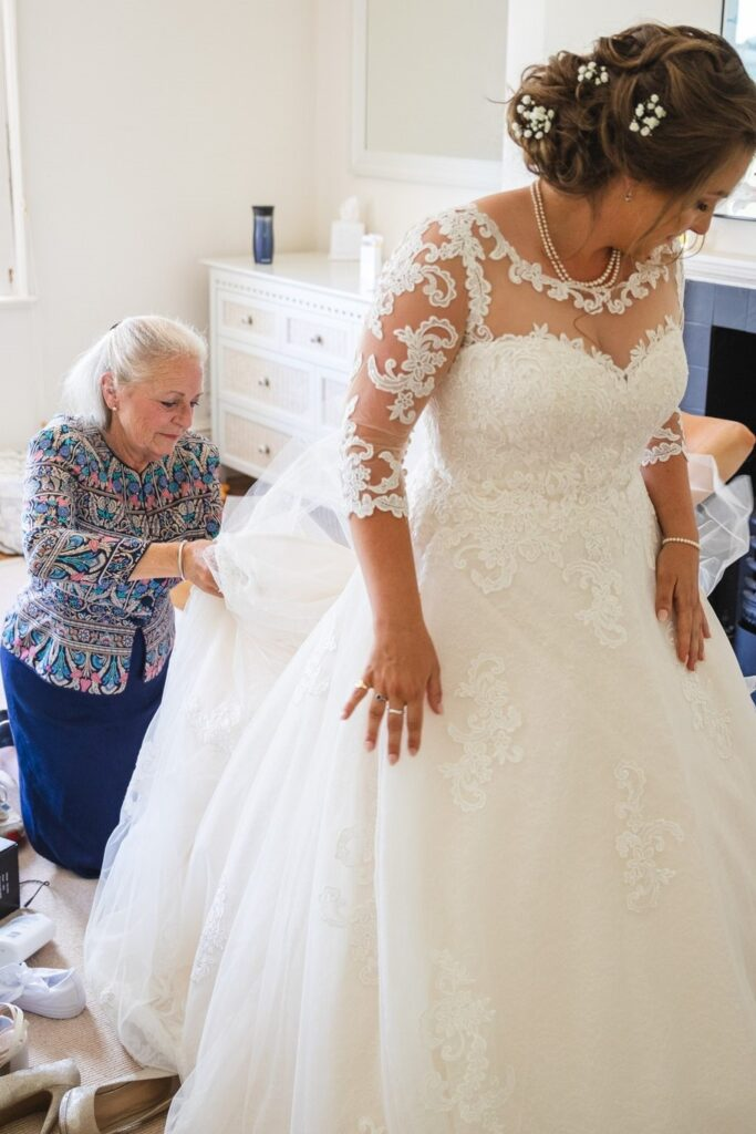 46 brides dress adjusted bridal prep winkfield berkshire oxfordshire wedding photography