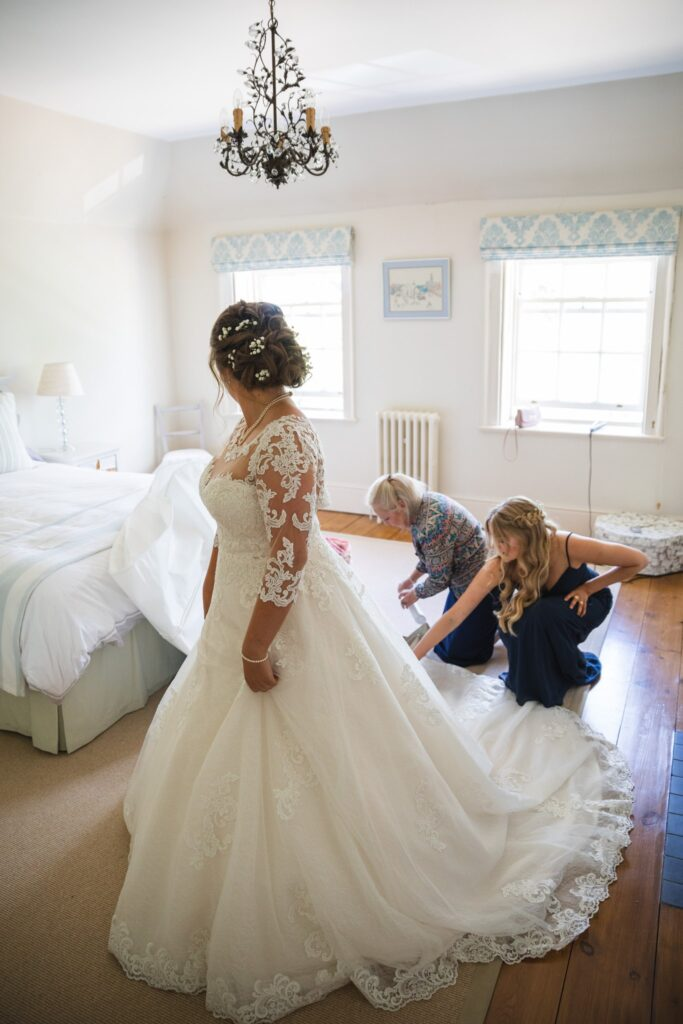 47 bride checks wedding dress train bridal prep winkfield berkshire oxford wedding photographer