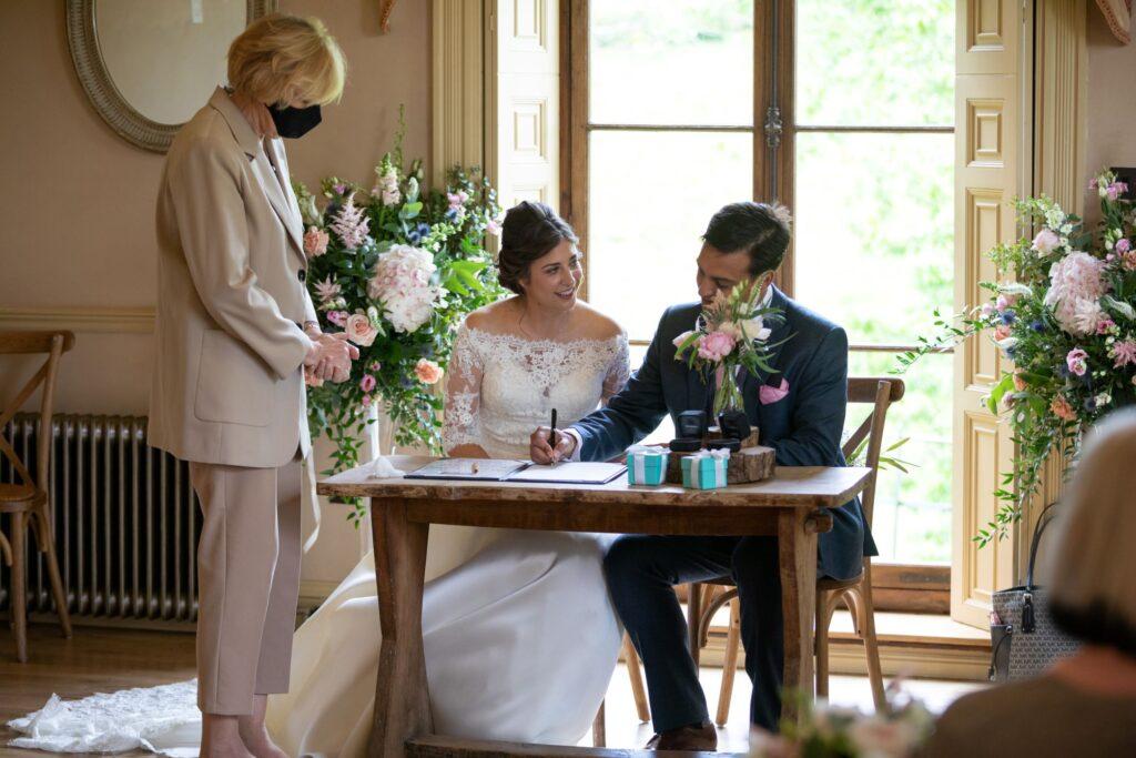 47 bride groom sign marriage register pauntley court gloucester oxfordshire wedding photographers