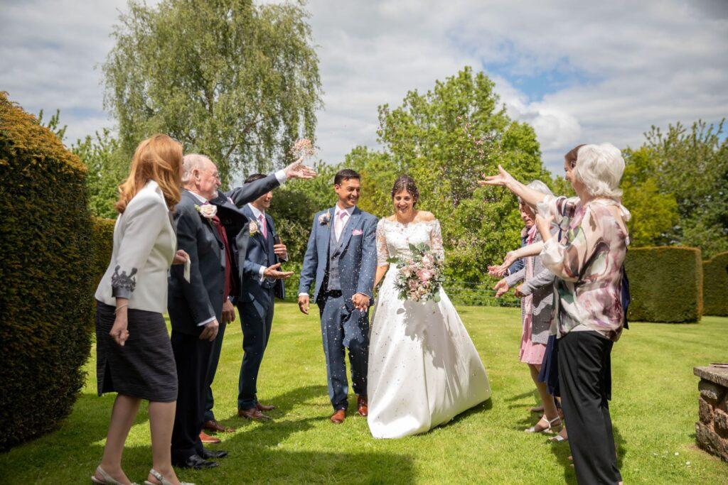51 bride grooms confetti shower pauntley court gardens gloucestershire oxford wedding photographer