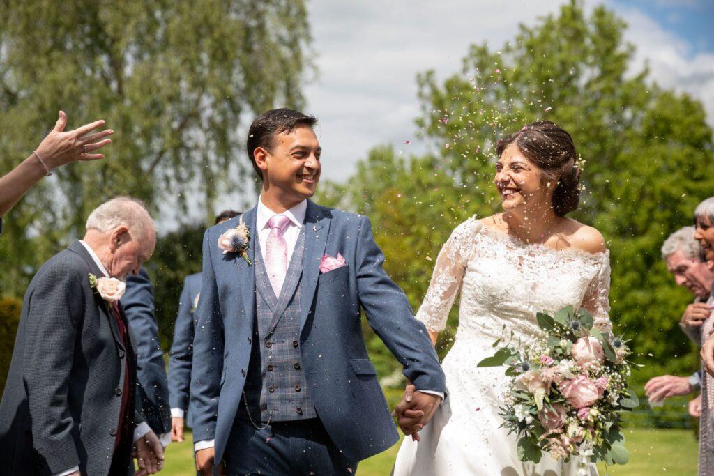 52 laughing bride groom enjoy confetti parade pauntley court gardens gloucester oxford wedding photography