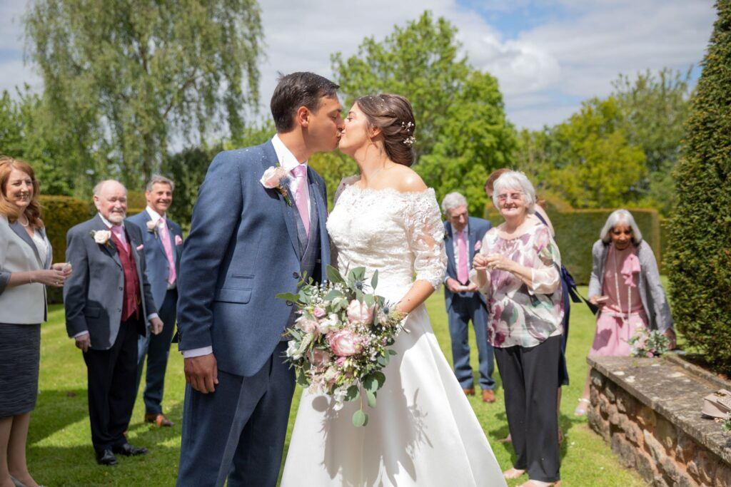 53 bride groom kiss pauntley court gardens gloucester oxfordshire wedding photographer