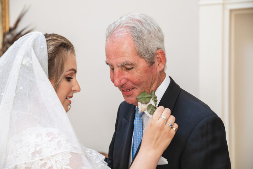 55 bride fixes fathers buttonhole flower winkfield berkshire oxfordshire wedding photography