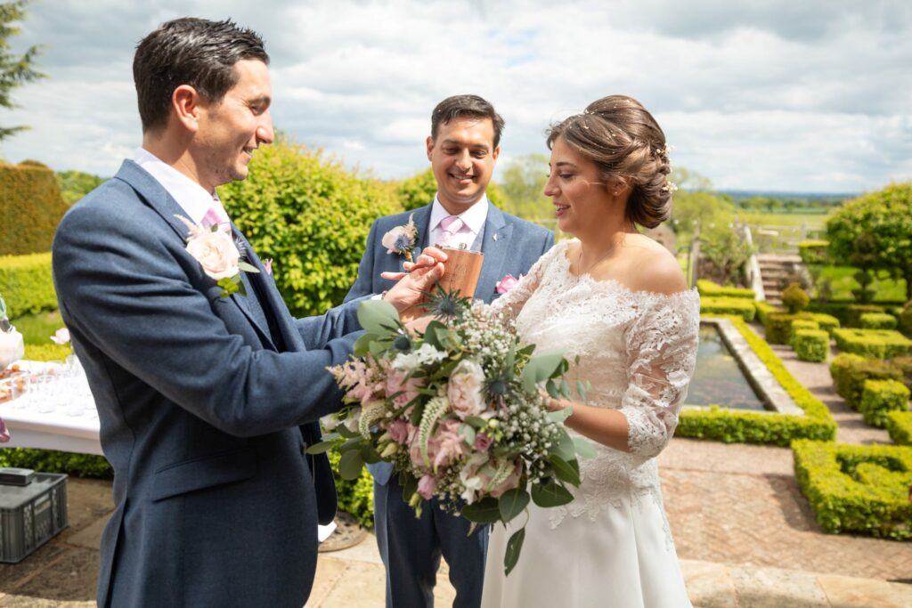 55 bride offered drink canapes reception pauntley court gardens gloucester oxfordshire wedding photography