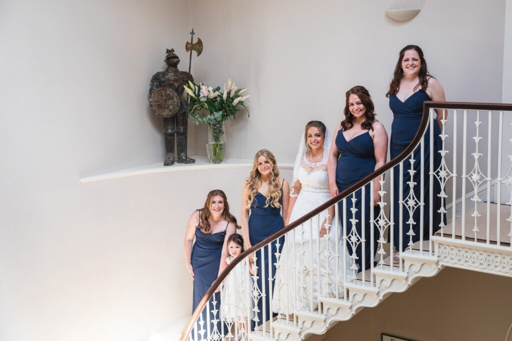57 bride bridesmaids flowergirl staircase portrait winkfield berkshire oxford wedding photographer