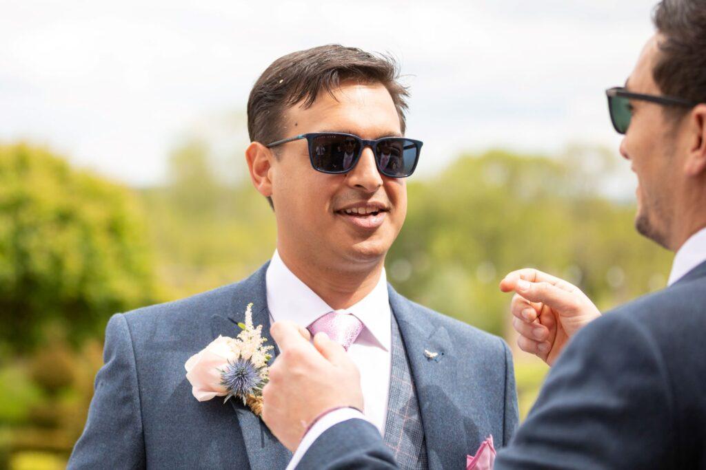 58 smiling groom sunglasses pauntley court garden reception gloucester oxford wedding photography