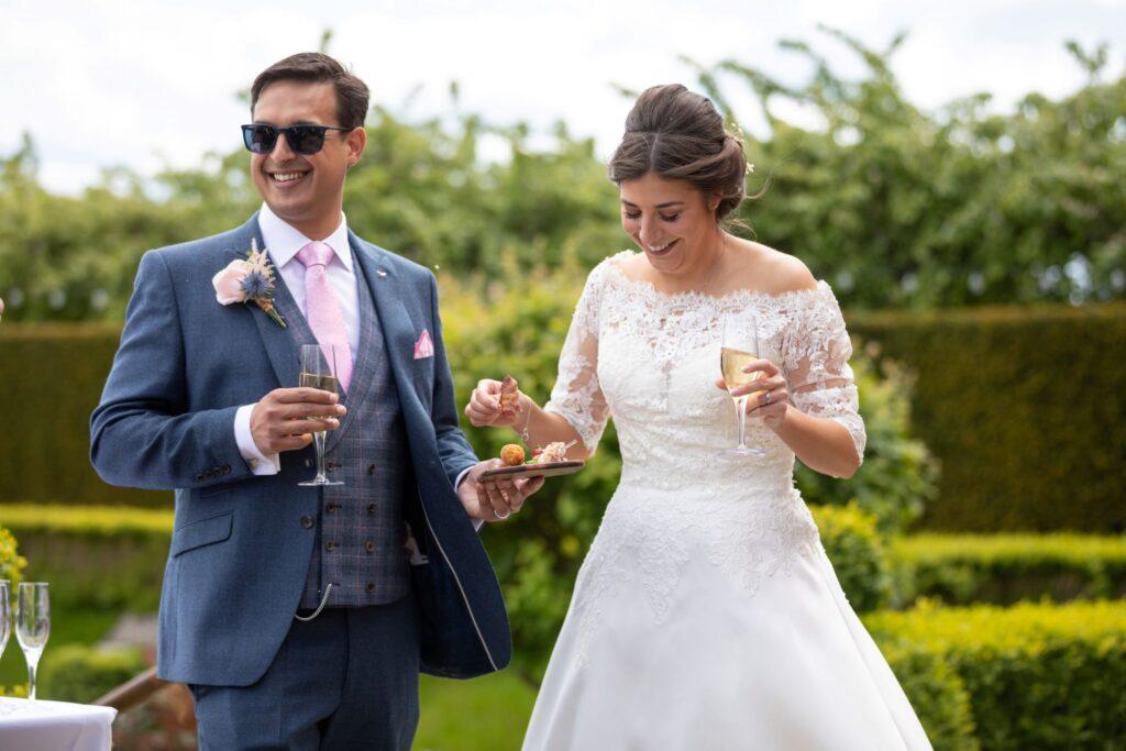 59 smiling bride groom garden reception pauntley court gloucester oxfordshire wedding photographer
