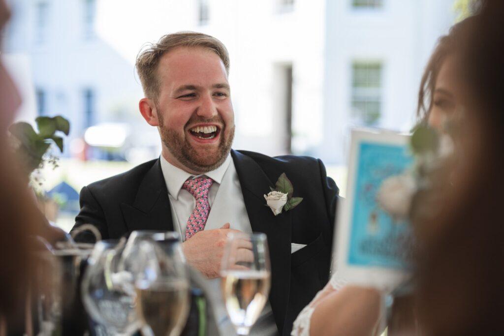61 laughing groom winkfield windsor berkshire oxfordshire wedding photography