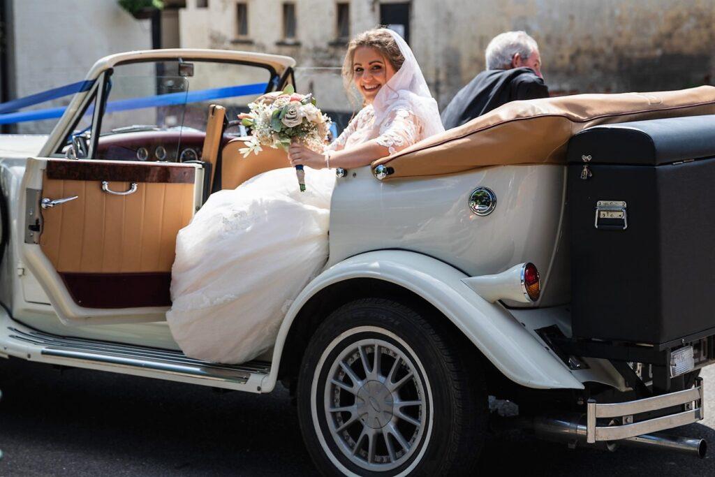 63 brides vintage bridal car arrives st marys church winkfield berkshire oxford wedding photographers