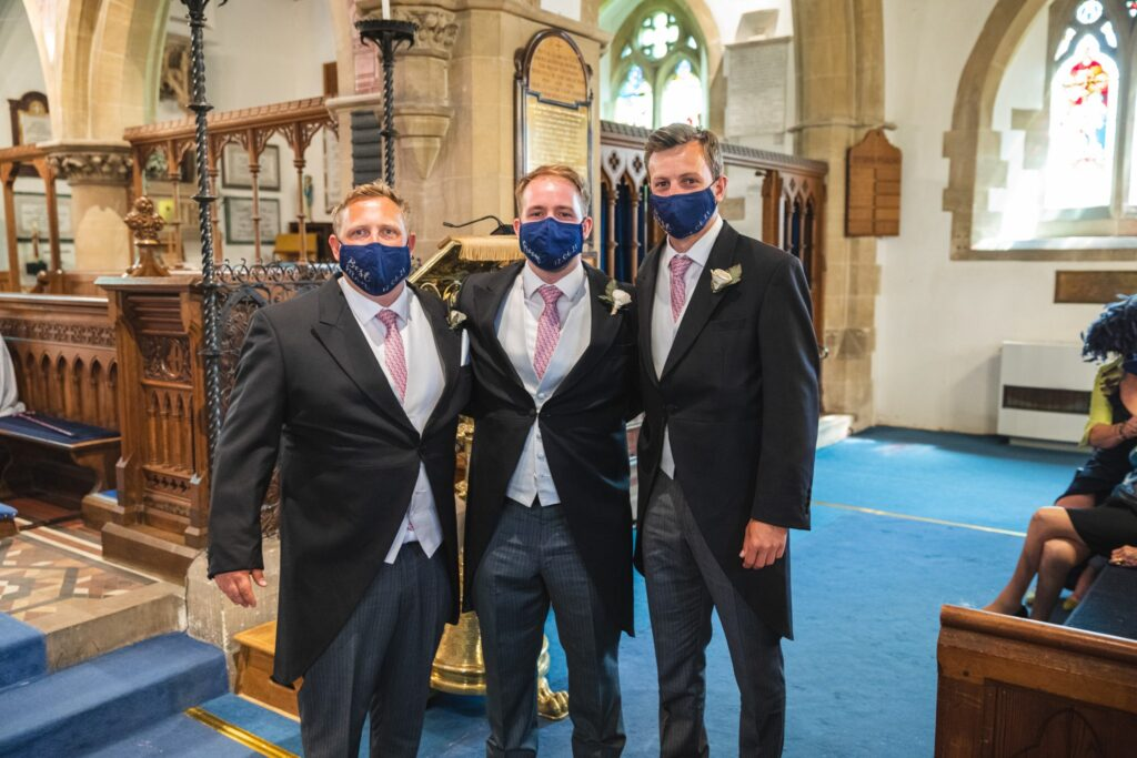64 face covered groom groomsmen wait bride st mary church ceremony winkfield berkshire oxford wedding photography