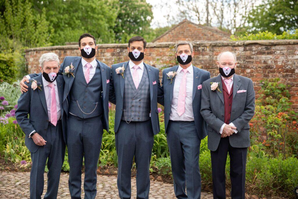64 male wedding party wear covid face masks pauntley court garden reception gloucester oxford wedding photography