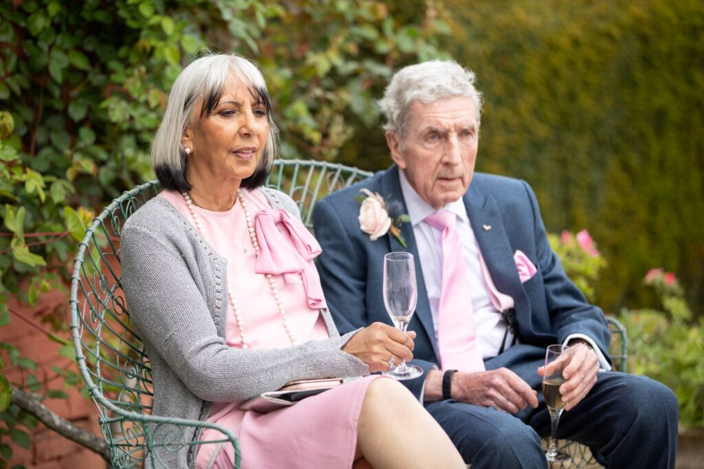 66 guests enjoy champagne drinks garden reception pauntley court gloucester oxfordshire wedding photographers