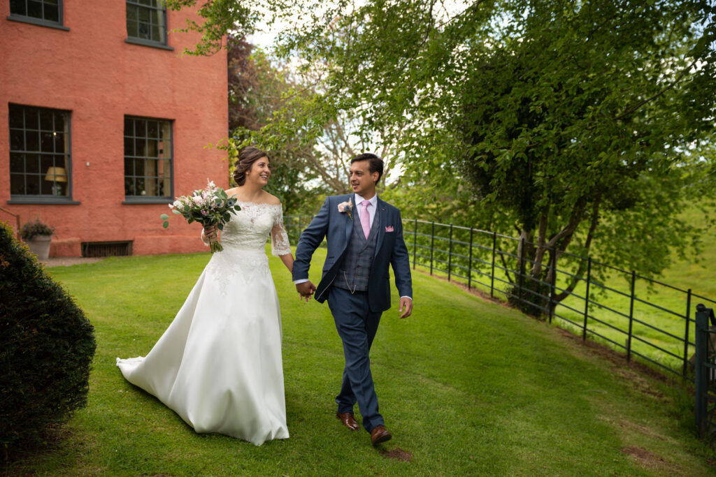 67 bride groom stroll holding hands pauntley court gardens gloucester oxfordshire wedding photography