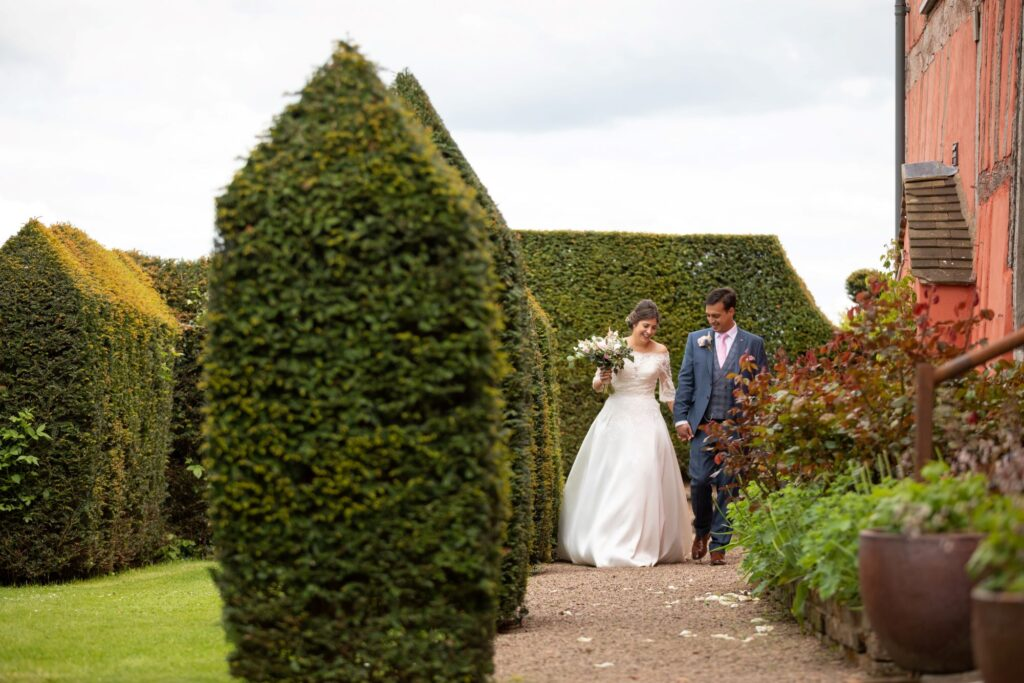 68 smiling bride groom stroll gardens pauntley court gloucestershire oxford wedding photography