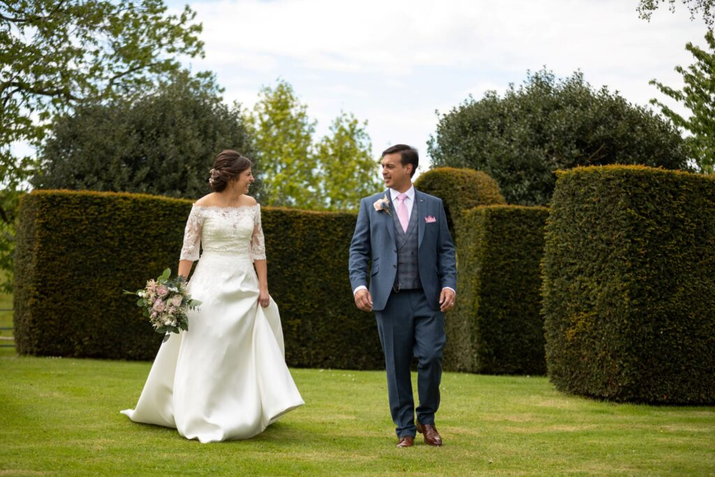 69 laughing bride groom walk together pauntley court gardens gloucestershire oxfordshire wedding photographers