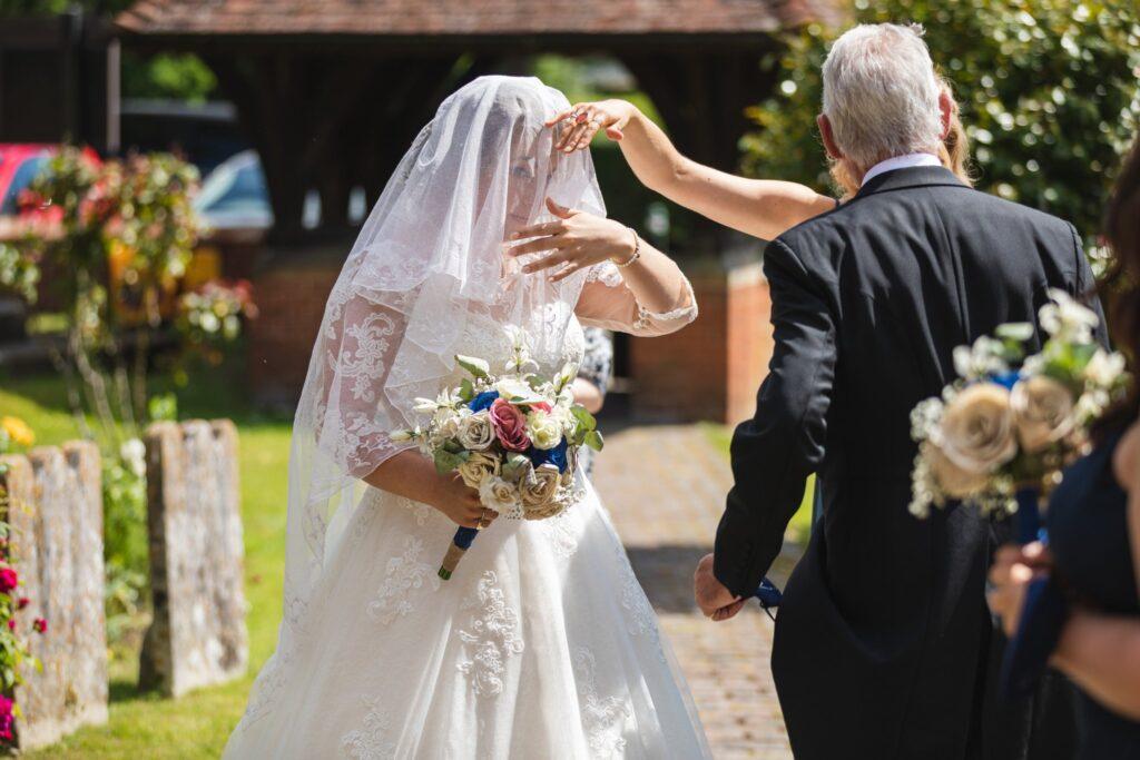 70 brides veil lowered st marys churchyard winkfield berkshire oxford wedding photography