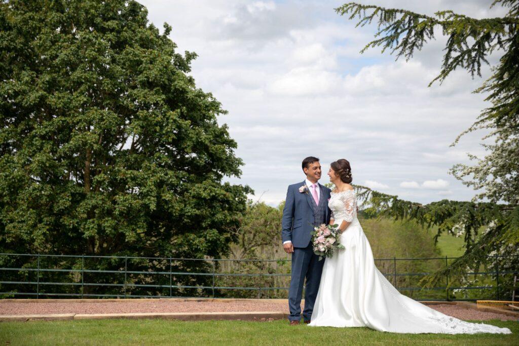 70 smiling bride grooms romantic moment pauntley court grounds gloucestershire oxfordshire wedding photographers