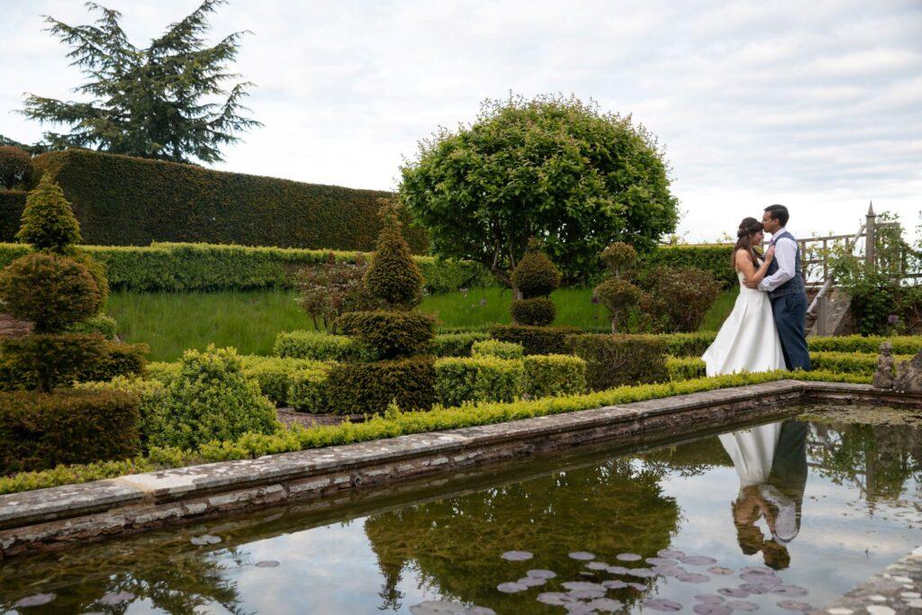 71 bride grooms water reflection pauntley court gardens gloucestershire oxford wedding photographers