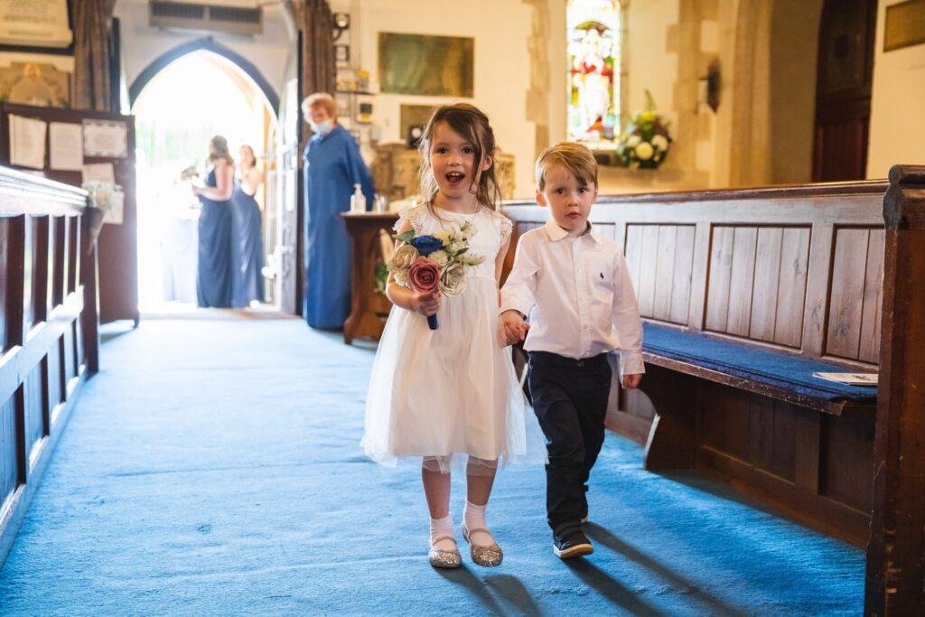 72 flowergirl pageboy enter st marys church winkfield berkshire oxfordshire wedding photographers