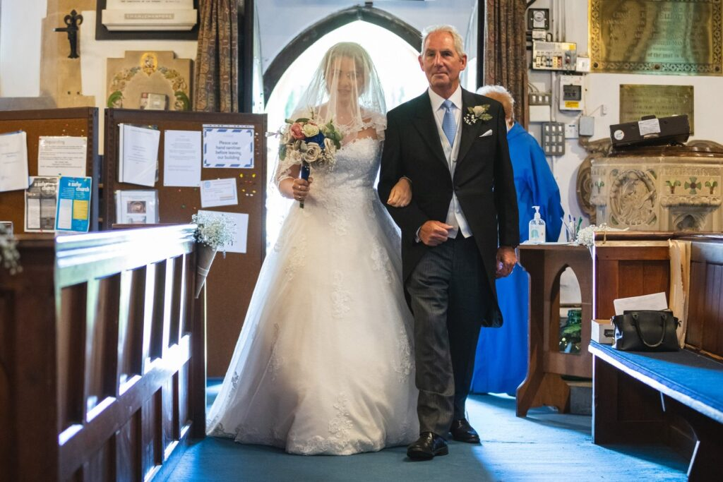 73 bride father of bride enter st marys church ceremony winkfield berkshire oxfordshire wedding photography