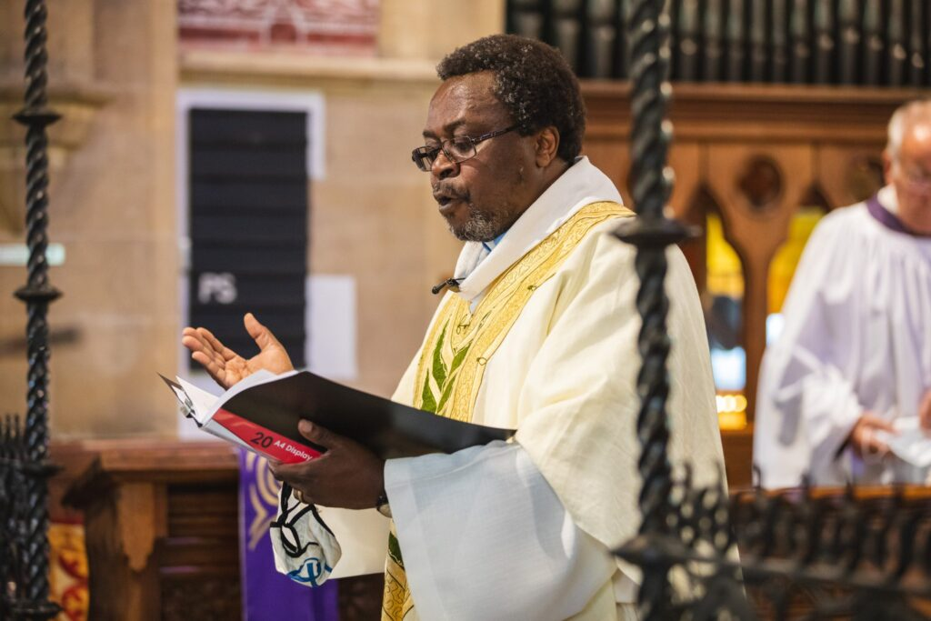 75 priest conducts marriage ceremony st marys church winfield berkshire oxford wedding photographers