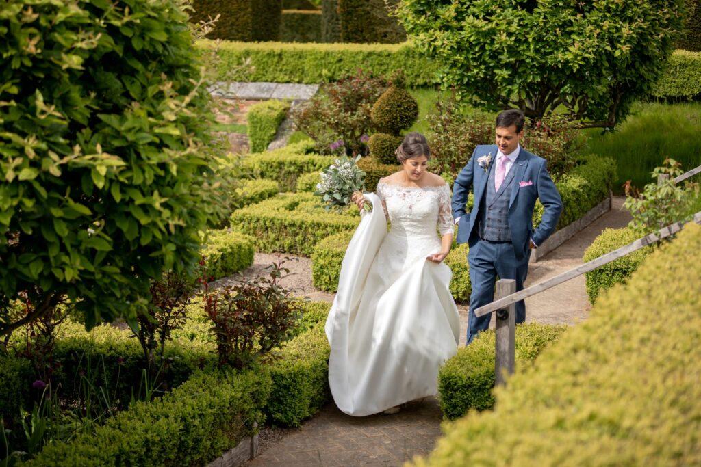 76 bride groom stroll pauntley court formal garden gloucester oxford wedding photographer