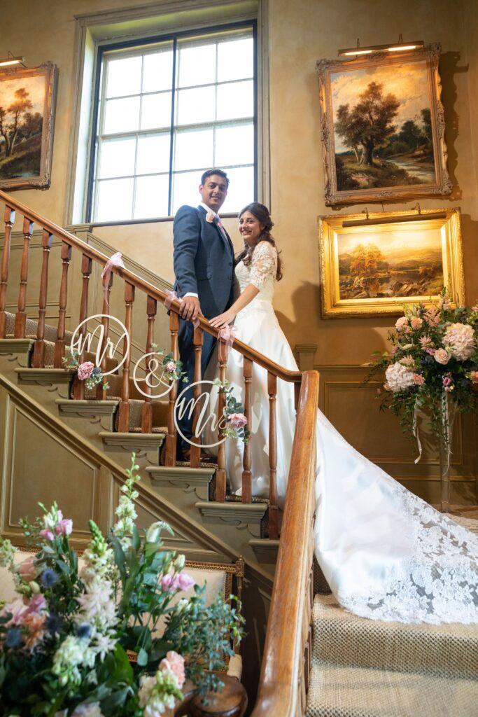 79 bride groom staircase portrait pauntley court gloucestershire oxford wedding photographer