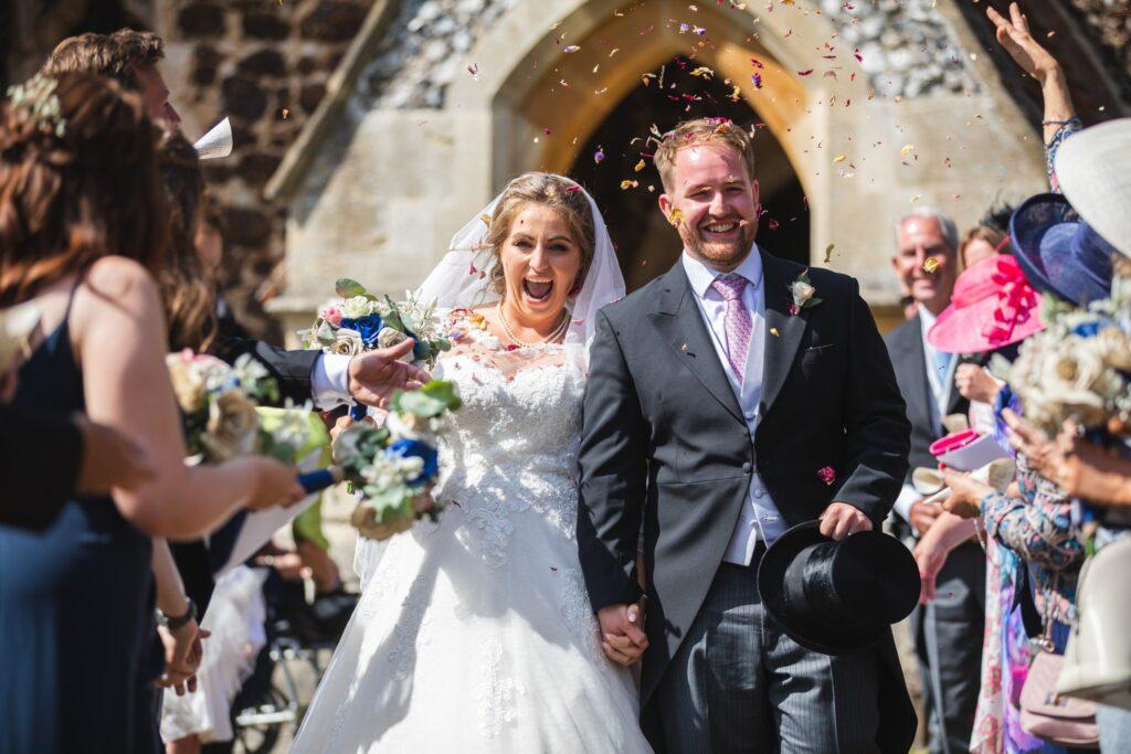 82 happy bride groom enjoy confetti parade st marys church winkfield berkshire oxfordshire wedding photographers