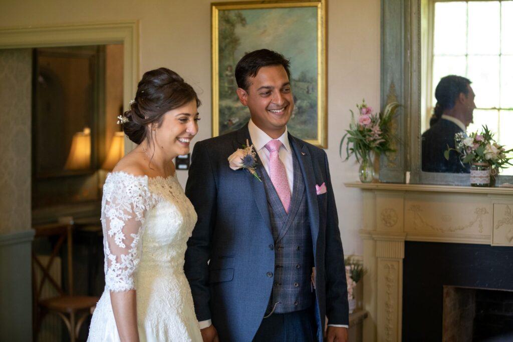 83 bride groom enter wedding breakfast pauntley court gloucester oxfordshire wedding photographer